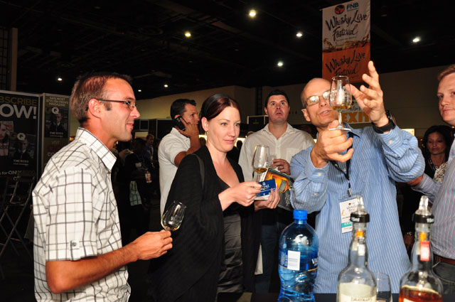 Whisky Live 2010 - Master distiller of Drayman's Single Malt Whisky - Moritz Kallmeyer - displays a dram of SA's first Single Malt made on the Highveld to festival goers