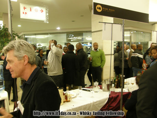 People Enjoying Their Drams at the Kaya FM / Wade Bales Wine & Malt Whisky Affair