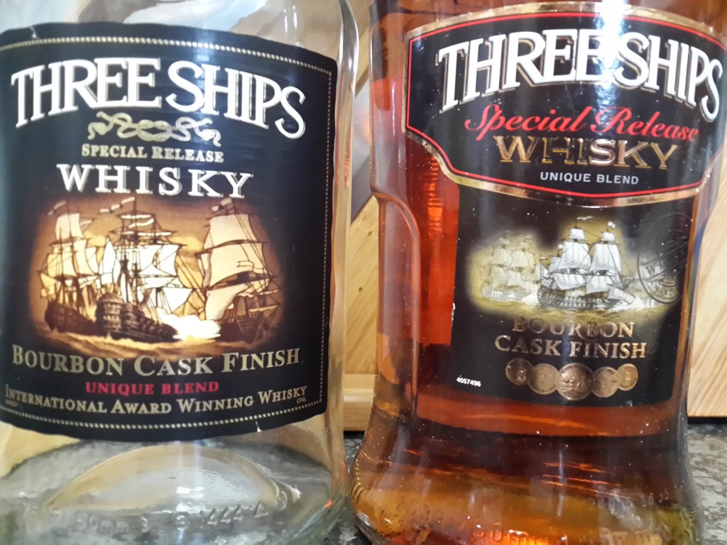 Three Ships Old Bottle vs New Bottle - Front View Closeup