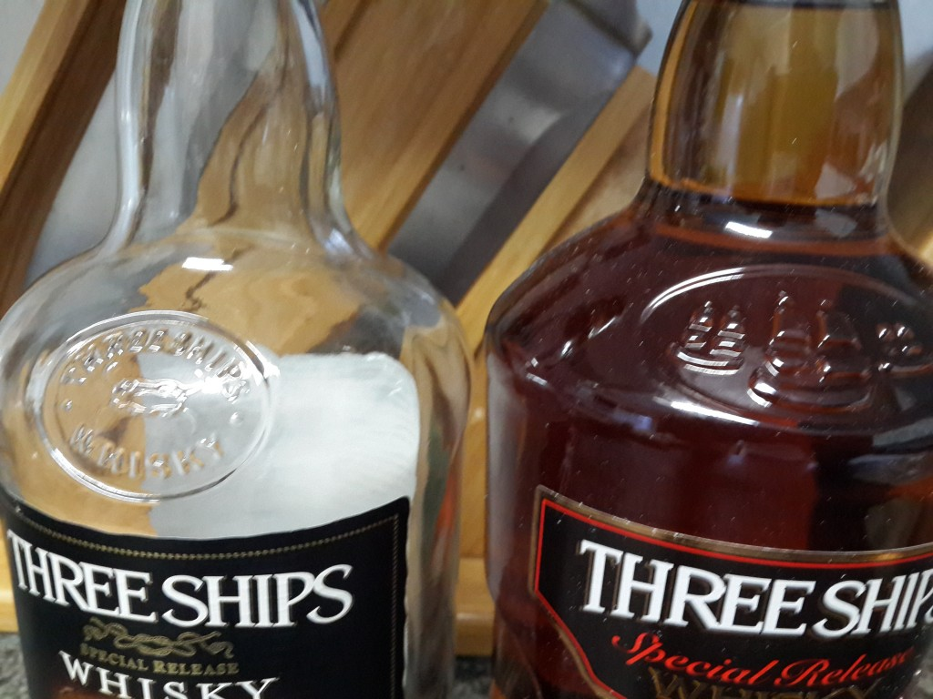 Three Ships Old Bottle vs New Bottle - Embossed Logo Differences