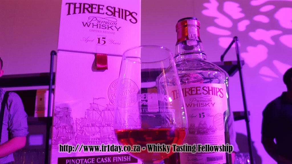 Three Ships Pinotage Cask Finish Whisky bathed in pink light